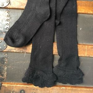 UO black lacey over the knee socks with ruffles